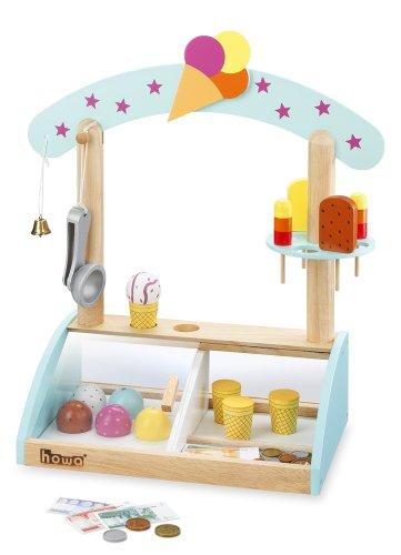 Tenderete de helados, de madera. Incluye6bolas, 4 barquillos, 4polos, servidor. Incluyedinero de juguete. Altura:44,0cm. Ancho: 42cm. Profundidad: 20cm.
