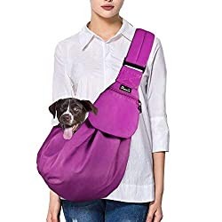Lady wearing a fuchsia coloured hands free Slowton pet carrier sling with a small brown dog inside it.