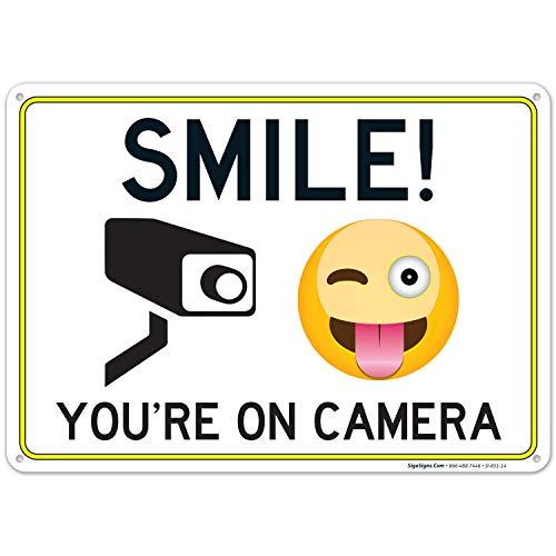 Señal de vigilancia de vídeo de Smile You're on Cámara, 10 x 14 pulgadas, aluminio inoxidable, resistente a la intemperie/decoloración, fácil de montar, para uso en interiores y exteriores, fabricado en Estados Unidos por SIGO Signs