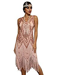lady wearing art deco peach color dresses 20s style with fringe at bottom