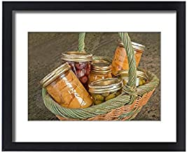 Media Storehouse Framed 20x16 Print of Wicker Basket of Home Canned Foods (Peaches, Olives and Cherries) (19320509)