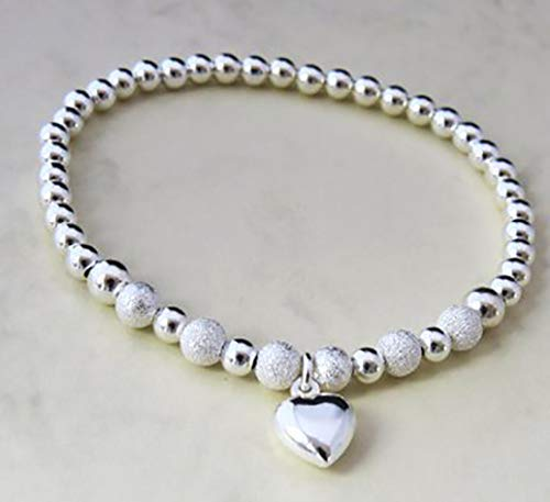 Silver Colour Round Beads With Star Dust Beads Heart Charms Stretchable Bracelet