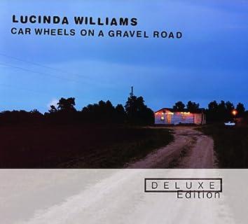 Car Wheels On A Gravel Road