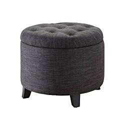 Round gray storage ottoman with a tufted top.