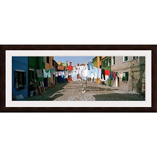 "GREATBIGCANVAS Clothesline in a Street, Burano, Veneto, Italy Espresso Framed Wall Art Print, 48""x16""x.75"