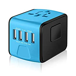 A small, square black and blue international travel plug adapter.