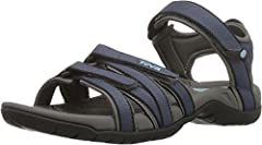 Sporty sandal featuring logo and multiple straps with hook-and-loop closures Nylon stability shank EVA topsole with Microban zinc Compression-molded EVA midsole Shock Pad heel Traction outsole with water-channeling lugs