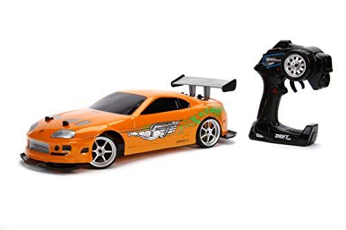 Jada Toys Fast & Furious RC Auto Drift 1995 Toyota Supra Turbo-Coche teledirigido con 2 Canales, función de Carga USB, 4 neumáticos de Repuesto, Incluye Pilas, 1:10, Color Naranja (253209003)