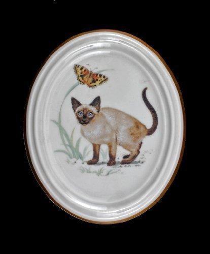 Médaillon en porcelaine avec motif chats