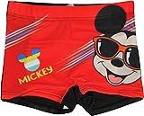 Pantaloncini da bagno tagliati in colori vivaci con grande grafica Topolino. Pantaloncino con elastico in vita non compressivo.