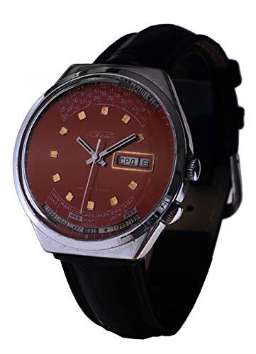 Reloj original Raketa de pulsera de fabricación Ex-Unión Soviética URSS CCCP calendario perpetuo. Serie numerada. Color rojo. Día de la semana y meses en cirillico