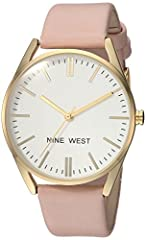 Domed mineral crystal lens; matte white dial with gold-tone hands and markers; black printed outer minute track Pink strap with buckle closure Japanese-quartz Movement Case Diameter: 40mm Not water resistant