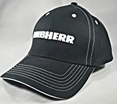 Black Liebherr Crane Trucker Hat. Embroidered with Liebherr logo in white stitching. 6 panel design. Velcro closure. 60% Cotton, 40% Polyester. We 100% GUARANTEE our products! Drill Deep or GO HOME is our motto!