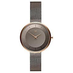 "MVMT MOD ultra-thin minimalist watches are 32 MM in diameter, 7.4 MM thick; inspired by clean lines, this watch is perfect for the modern woman Known as the ""G2,"" this watch's concave case is made from brushed rose gold stainless steel; rose gold han..."