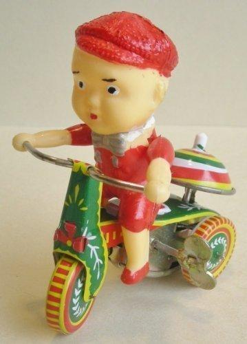 Junge auf Dreirad aus Blech zum Aufziehen, Blechspielzeug