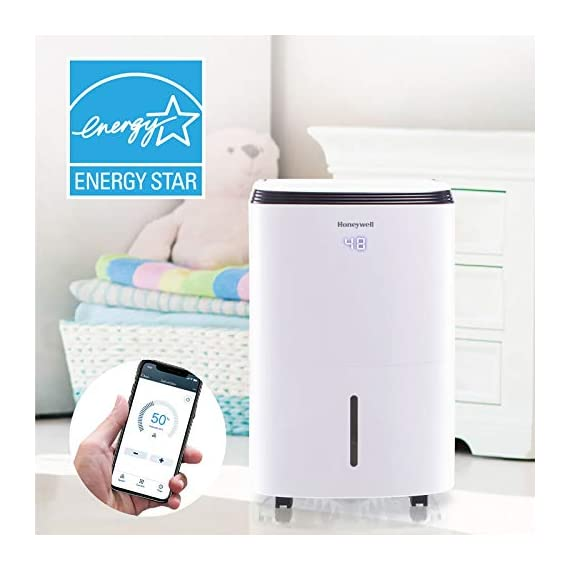 Honeywell Basement & Small Room Up to 1000 Sq. Ft, TP30AWKN Smart Wi-Fi Energy Star Dehumidifier, 30 Pint, White 2 POWERFUL DEHUMIDIFIER FOR ROOMS UP TO 4000 SQUARE FEET: This powerful beast effectively removes up to 70 pints of moisture from the air (50-Pint 2019 DOE Standard) to protect walls, curtains, furniture and appliances from excess household moisture. Ideal for large basements, living rooms, cellars, and storage rooms. PEACE OF MIND WITH A BRAND YOU TRUST: Honeywell Dehumidifiers are top rated by an independent, US-based product safety-testing agency since 2016 and all Honeywell Dehumidifiers are backed by an outstanding warranty. Plus, if you ever need help, the Honeywell Home Comfort customer service hotline connects you directly to an in-house customer support team who are ready to help (during office hours). SMART & VERSATILE: Wi-Fi-Enabled and compatible with Amazon Alexa voice commands, the Honeywell Smart Dehumidifier can be controlled from almost anywhere. Change humidity and fan-speed settings without moving away from your busy routine.