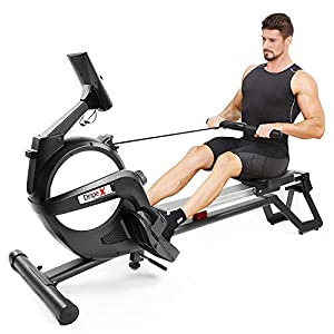 man on a dripex rowing machine