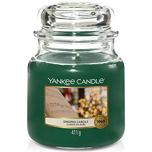 Yankee Candle candela profumata in giara media   Cantando canti natale   durata: fino a 75 ore