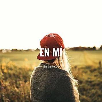 En mi