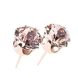 14k Rose Gold-plated Sterling silver stud earrings made with sparkling Vintage Rose crystal from Swarovski. 14k Rose Gold-plated Sterling silver setting, post and scrolls stamped 925. The earrings measure 6mm x 6mm. Gift box. The strong vibrant colou...