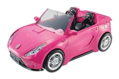 ​ Hit the open road with the Barbie convertible! ​ The two-seater car is designed in sparkly pink with the Barbie silhouette as hood ornament. ​ Realistically designed wheels really roll for driving play. ​ Upholstery labels and seatbelts in the inte...