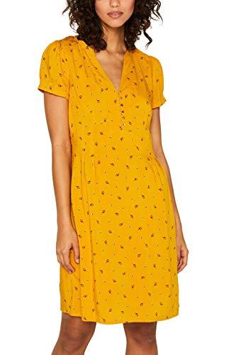 Vestido amarillo con escote en V abotonado. Estampado.