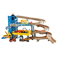 """A one-stop shop for real-world adventures! Four levels of activity including a spiral ramp and real working elevator. Features a premium car wash to get cars """"clean."""" Service station to """"repair"""" your Matchbox vehicles. Includes one Matchbox tow truck..."""