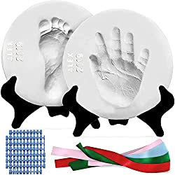 traditions to start on baby's first christmas, christmas ornament to make with baby's handprint