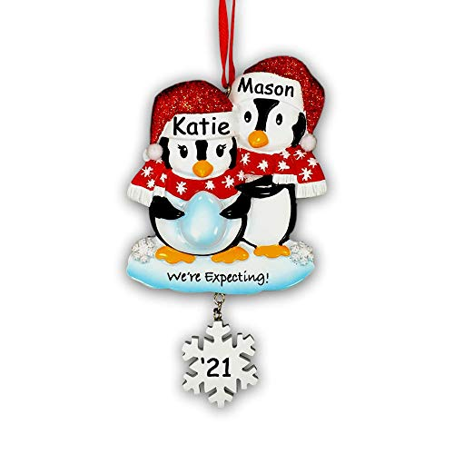 Personalized Pregnant We're Expecting Penguin Couple with Baby Egg with Glittered Santa Stocking Cap and Scarves and Snowflake Detail Hanging Christmas Ornament with Custom Name and Date (Optional)