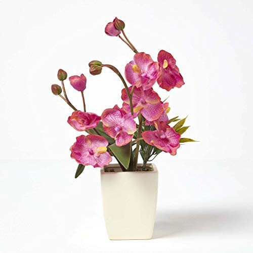 Homescapes Medium Cerise Artificial Orchid with Lifelike Silk Flowers, Buds & Long Green Leaves Dark Pink Oriental Phalaenopsis Flower in Small Planter Square Cream Pot 40cm Tall For Indoor Decoration