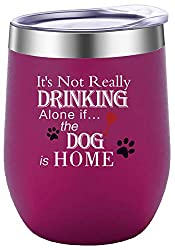 "Fuchsia coloured wine tumbler with the words ""It's Not Really Drinking Alone if the Dog is Home"" printed on the front."