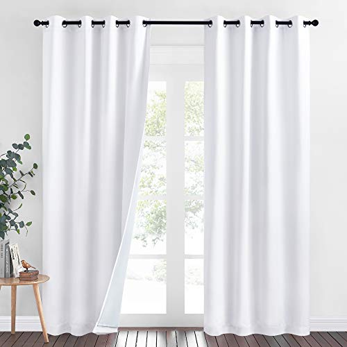 NICETOWN Dust Isolate Sound Barrier 100% Blackout Divider Curtains 84 inches Long, Non-Oily Particle, Noise, Cold & Heat Blocking Drapes Multiple Protection for Nursery/Daytime Sleep (White, 2 PCs)