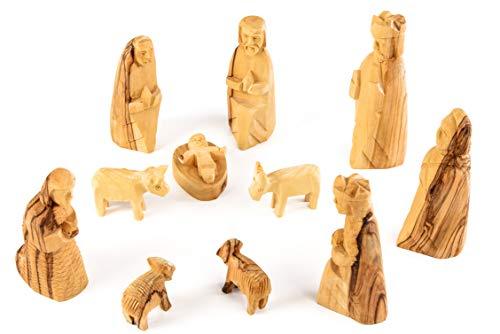 Krippenfiguren einfacher Stil. 11-teilig. In Bethlehem aus Olivenholz handgeschnitzt. Höhe der stehenden Figuren circa 10 cm.