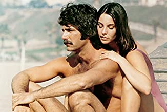 Sam Elliott and Kathleen Quinlan in Lifeguard Bare Chested on Beach 24x18 Poster