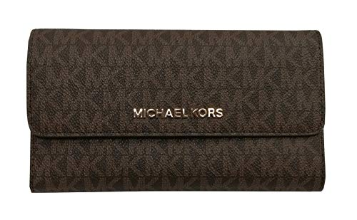 """Measures approximately Width: 7"""" Height: 4"""" Depth: 1"""". Flap style snap closure on the front and zippered accordion pocket on the back. Polished hardware """"MICHAEL KORS"""" in block letters on center of front flap. Interior: 4 multi function slot compartm..."""