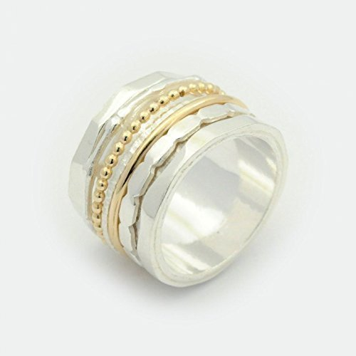Sterling silver spinner ring with gold bands custum made