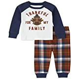 They're ready to catch some zzz's in the softest and comfiest cotton pajamas from The Children's Place Top features 'Thankful for my family' with turkey graphic design at front; styled with rib-knit crew neck and banded sleeve cuffs Pants have allove...