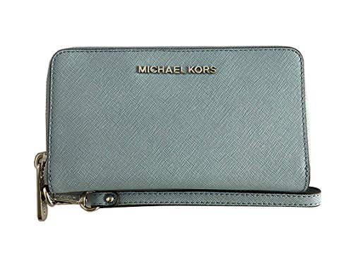 Made of saffiano leather with logo detail on front; Zip around for closure; 1 ID slot 5 credit card slots; 1 slide pocket; Iphone slot; Full leather lining 7 inches removable leather wristlet strap; Silver hardware Measurements: Length: 7 x Height: 4...