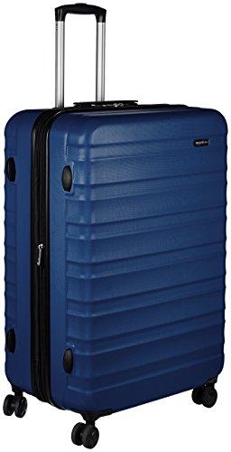 Amazon Basics - Maleta de viaje rígidaa giratoria - 78 cm, grande, Azul marino