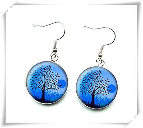 Pendientes de árboles negros sobre fondo azul, joyería de cristal cúpula pura hecha a mano