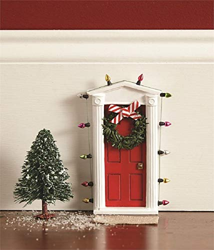 "Standing miniature dimensional door surrounded with ""lights"" and tiny faux wreath with bow allows special entry for fairies and elves"