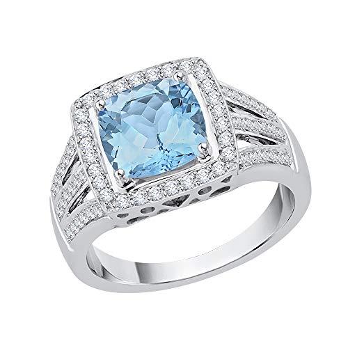KATARINA Anillo de compromiso de topacio azul de talla cojín y diamantes en oro de 14 k (1 1/10 cttw, G-H, I2-I3)