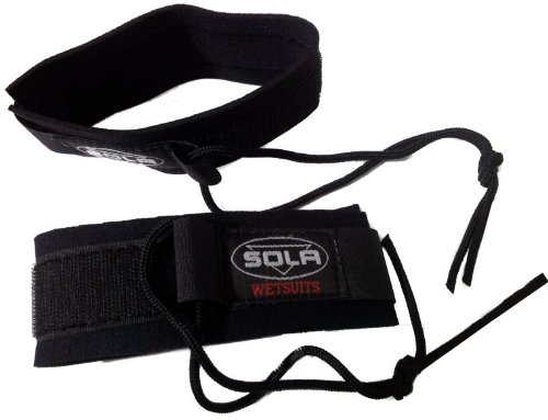 A Pair of Sola Fin Tethers / flipper savers. Keep your fins from floating away if one is kicked off. by Soles Up Front