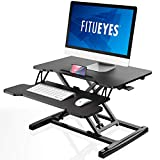 FITUEYES Standing Desk Converter Black Height adjustable with Gas Spring Stand up Desk for Computer L64xW40cm SD260001WB