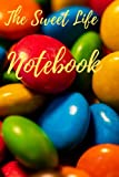 Notebook: 120 lined pages, with an M&M candy themed cover. (Size 6x9 ).