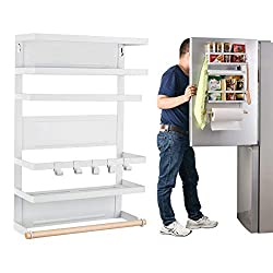 The magnetic organizer rack attaches to the fridge for space saving tiny house furniture.