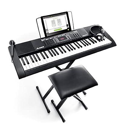 Alesis Melody 61 MKII – Teclado de piano eléctrico con 61 teclas, altavoces integrados, auriculares, micrófono, soporte para piano, atril y banqueta
