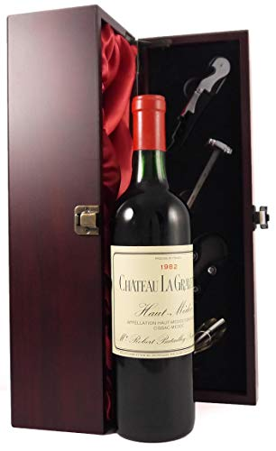 Chateau La Gravette 1982 Medoc in einer mit Seide ausgestatetten Geschenkbox. Da zu vier Wein Zubehör, Korkenzieher, Giesser, Kapselabschneider,Weinthermometer, 1 x 750ml