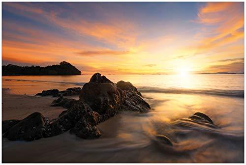 Wallario Glasbild Sonne über dem Meer mit Felsenlandschaft - 60 x 90 cm in Premium-Qualität: Brillante Farben, freischwebende Optik