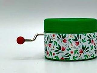 Caja de música color verde con un estampado hojas y la canción de Elvis de I can`t help falling in love